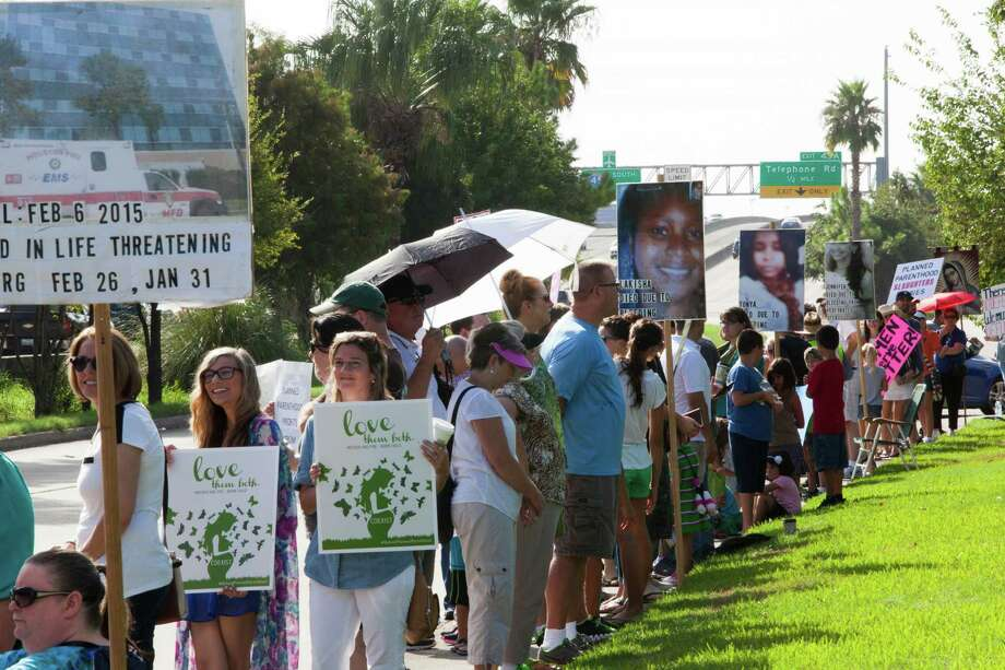 Several hundred people gather in front of Planned Parenthood in Houston to protests the abortions that take place in the clinic  in light of the secrete videos released targeting Planned Parenthood. The videos intend to show that Panned Parenthood profits from sales of fetal body parts for medical research, but the organization denies the allegations. Saturday, Aug. 22, 2015, in Houston. Photo: Marie D. De Jesus, Houston Chronicle / © 2015 Houston Chronicle
