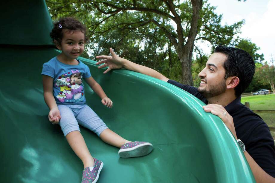 After getting laid off from his job in March, Maisam Otoum and his wife could no longer afford to send their daughter, Lamar, to childcare. Instead, he agreed to stay at home with the 3-year-old. Photo: Marie D. De Jesus, Staff / © 2015 Houston Chronicle