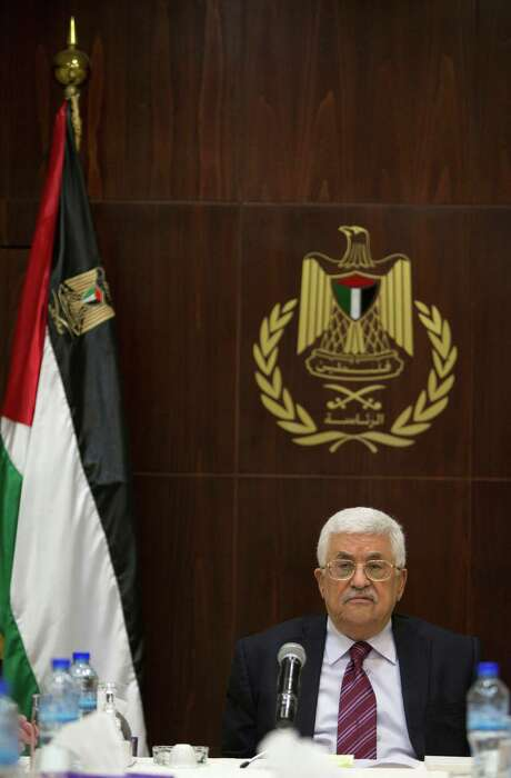 Palestinian President Mahmoud Abbas chairs a PLO executive committee meeting on Saturday. He reportely will resign his leadership post. Photo: Majdi Mohammed, STR / AP