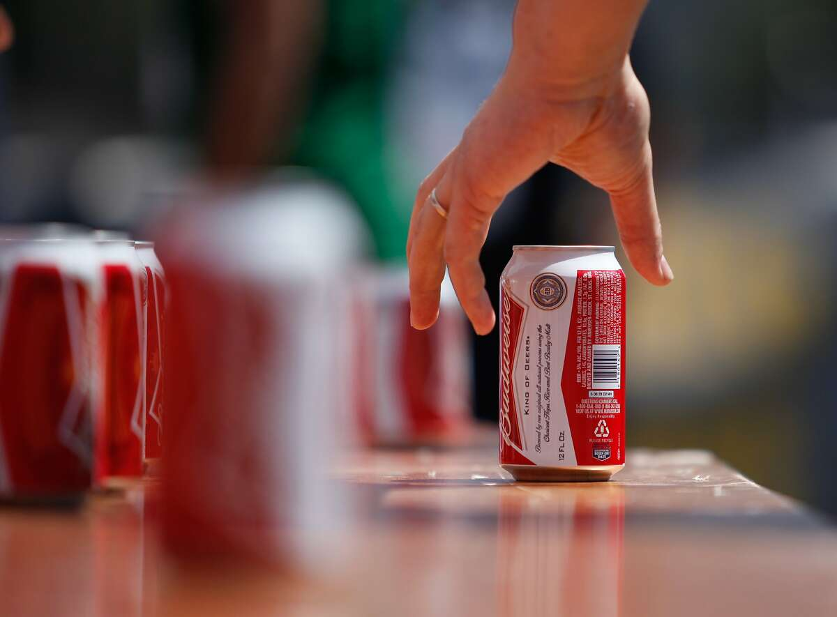 A runner takes a beer from the beer station during the Beer Mile World Classic on Saturday, August 22, 2015 in San Francisco, Calif. For the uninitiated, the beer mile consists of a mile long race, run as fast as possible, with a can of beer chugged in between each lap.