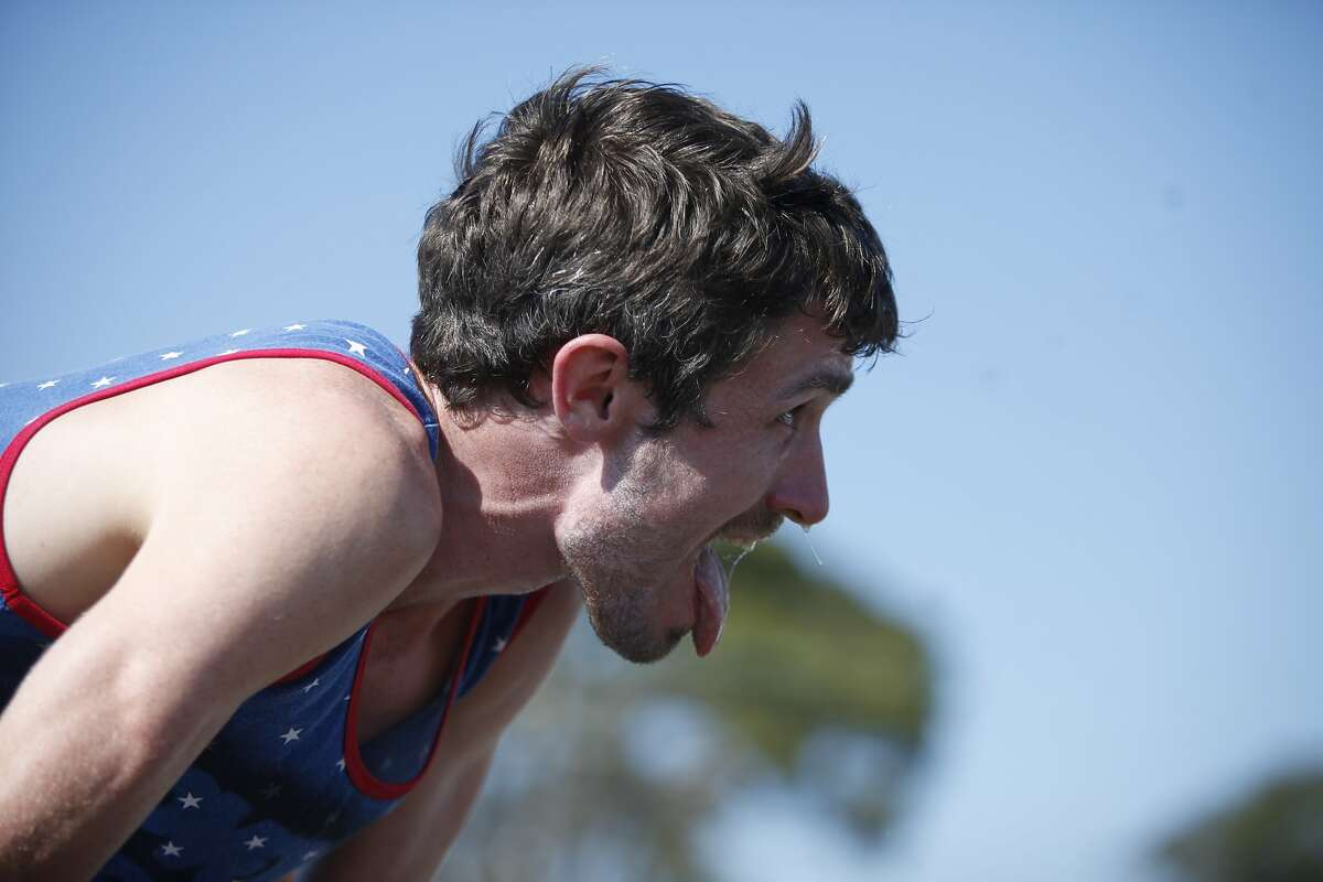 Paddy O'Leary of Ireland takes a deep breath after crossing the finish line during the Beer Mile World Classic on Saturday, August 22, 2015 in San Francisco, Calif. For the uninitiated, the beer mile consists of a mile long race, run as fast as possible, with a can of beer chugged in between each lap.