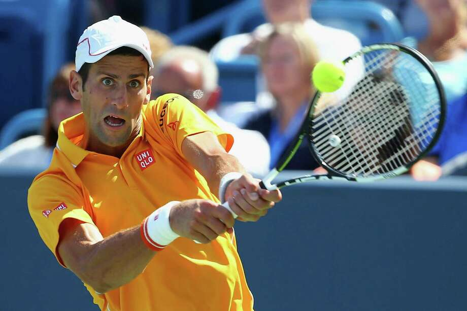 Novak Djokovic returns a backhand to Alexandr Dolgopolov en route to a victory in the semifinals at the Western & Southern Open on Saturday. Photo: Maddie Meyer, Staff / 2015 Getty Images