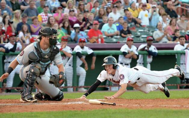 Tri-City ValleyCats' Bobby Wernes, right, slides home to beat the throw to Hudson Valley Renegades catcher Danny De la Calle on Cat's Dexture McCall's triple during Saturday's game at Joe Bruno Stadium August 22, 2015 in Troy, NY.  (John Carl D'Annibale / Times Union) Photo: John Carl D'Annibale / 00033060A