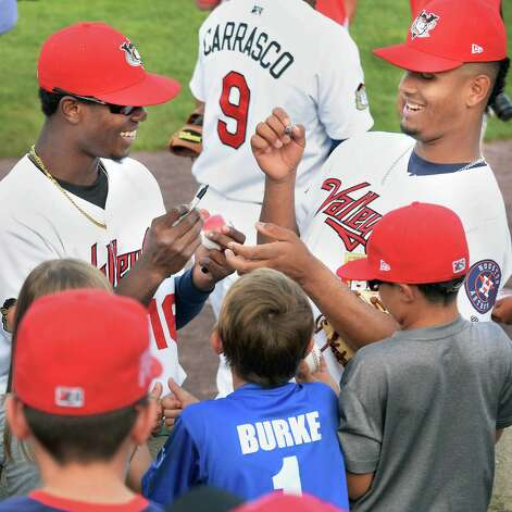 Tri-City ValleyCats' Hector Roa, left, and Yeyfry Del Rosario sign autographs before Saturday's game against the Hudson Valley Renegades at Joe Bruno Stadium August 22, 2015 in Troy, NY.  (John Carl D'Annibale / Times Union) Photo: John Carl D'Annibale / 00033060A