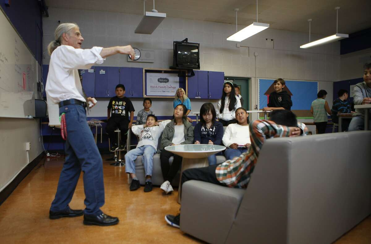 Paul Vignaux, math teacher at Hoover Middle School, explains some of the new equipment in their new Makerspace, named Hawk Family Garage, during a sixth grade class session on Friday, Aug. 21, 2015 in San Francisco, Calif. The school received a $100,000 grant from Salesforce to spend however they wanted.