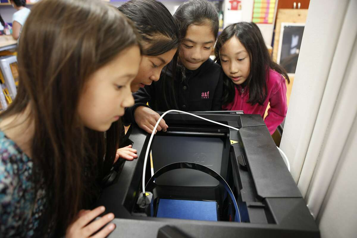 (L-R) Kathryn Quock, Fanny Zhang, Jasmine Chin and Abigail Lee examine the new 3D printer purchased for the new Makerspace, named Hawk Family Garage, during their sixth grade class at Hoover Middle School on Friday, Aug. 21 in San Francisco, Calif. The school received a $100,000 grant from Salesforce to spend however they wanted.