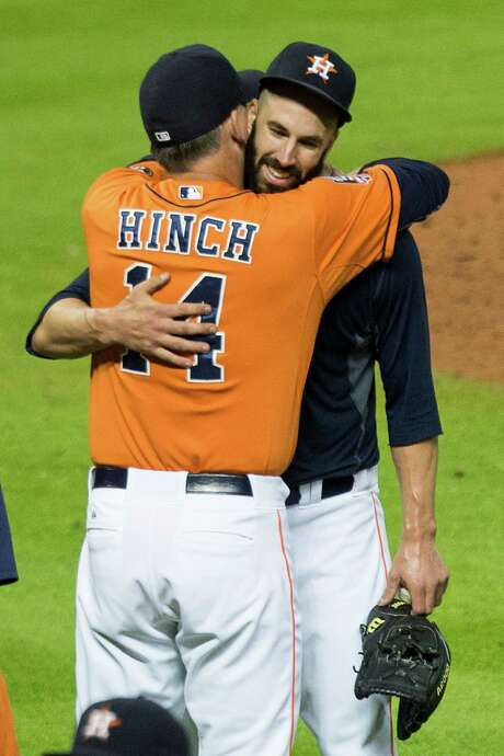 Mike Fiers' no-hit performance Friday earns an embrace from manager A.J. Hinch. Photo: Brett Coomer, Staff / © 2015 Houston Chronicle