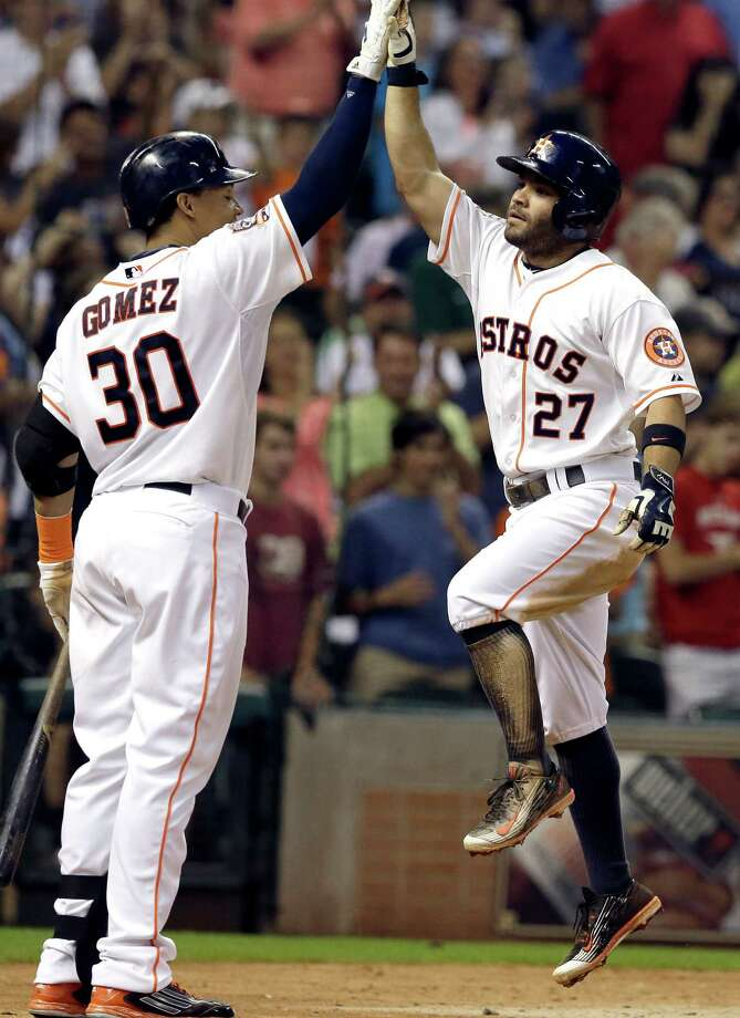 Carlos Gomez, left, high-fives Jose Altuve after Altuve's sixth-inning home run off Dodgers ace Zack Greinke. Photo: Pat Sullivan, STF / AP