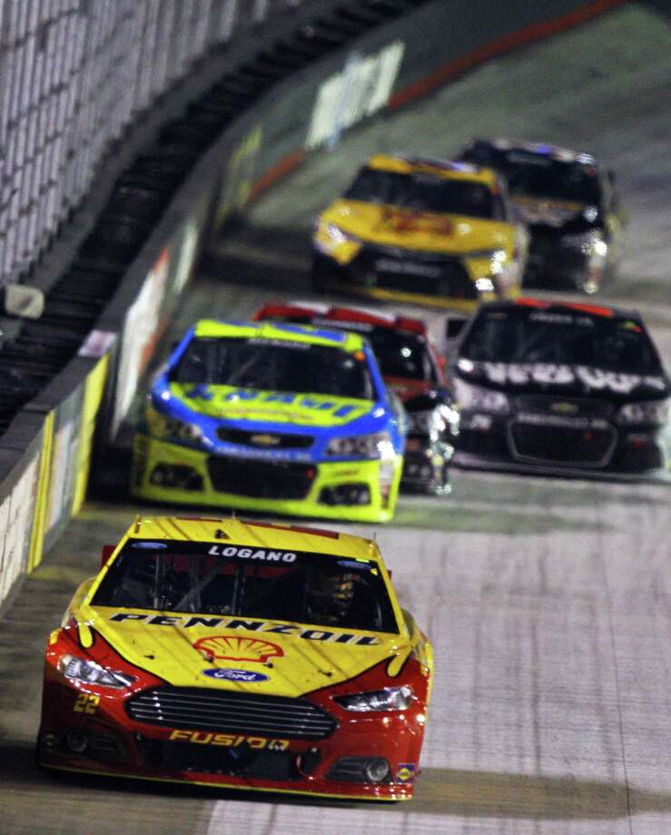 Joey Logano (22) leads a group of cars during the NASCAR Sprint Cup Series auto race, Saturday, Aug. 22, 2015, in Bristol, Tenn. (AP Photo/Wade Payne) ORG XMIT: TNWP121 Photo: Wade Payne / FR23601 AP