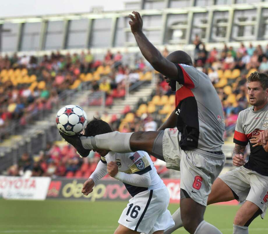 Nana Attakora of the San Antonio Scorpions (6) kicks the ball and the head of Lucas Scaglia (16) of the Jacksonville Armada during NASL soccer action at Toyota Field on Satuday, Aug. 22, 2015. Photo: Billy Calzada, Staff / San Antonio Express-News / San Antonio Express-News
