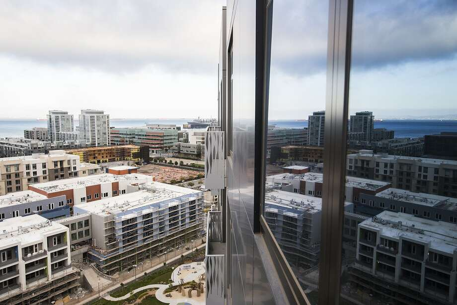Above: The new Azure Apartments look down on Mission Bay. The residential high-rise lures tenants with its appealing extras. Photo: Stephen Lam, Special To The Chronicle
