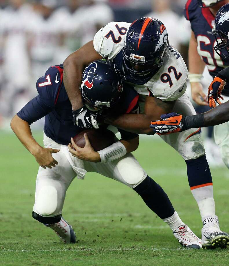 Texans quarterback Brian Hoyer (7), who had some difficulty escaping the pocket Saturday night, suffers a second-quarter sack at the hands of Broncos defensive tackle Sylvester Williams. Photo: Karen Warren, Staff / © 2015 Houston Chronicle