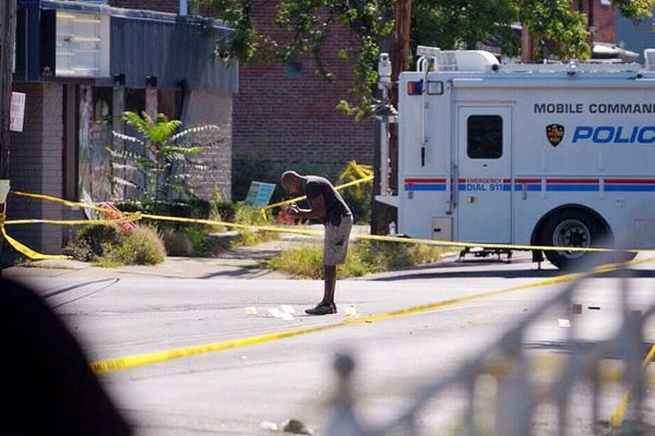 Troy Police investigate shooting at 112th Street on Sunday, August 23, 2015 in Troy, N.Y. Photo: Paul Buckowski