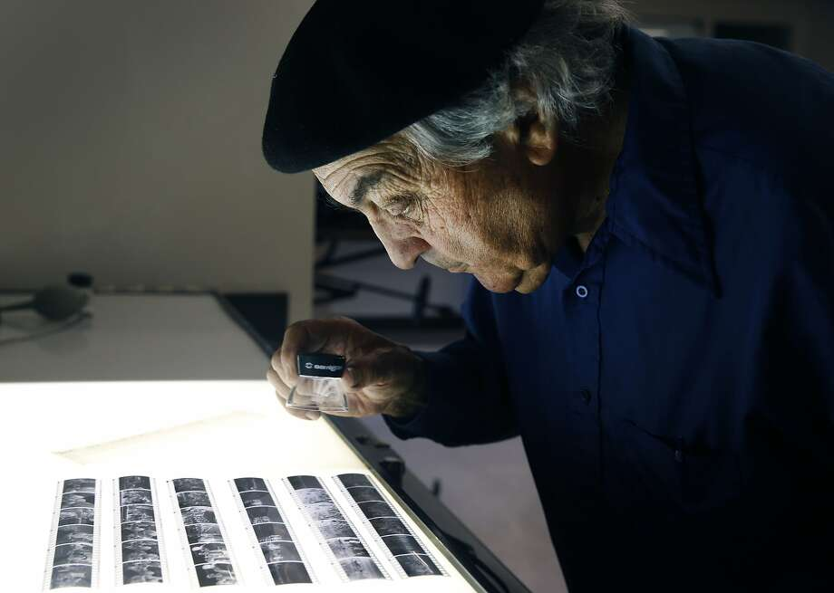 Photographer Jeffrey Blankfort edits black and white negatives at the Harvey Milk Photo Center in San Francisco, Calif. on Saturday, Aug. 22, 2015. The community photography center, which at one time had Harvey Milk as an active member, is marking its 75th anniversary with a retrospective exhibit by Blankfort. Photo: Paul Chinn, The Chronicle