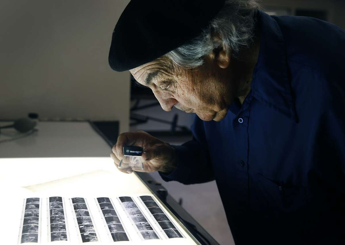 Photographer Jeffrey Blankfort edits black and white negatives at the Harvey Milk Photo Center in San Francisco, Calif. on Saturday, Aug. 22, 2015. The community photography center, which at one time had Harvey Milk as an active member, is marking its 75th anniversary with a retrospective exhibit by Blankfort.