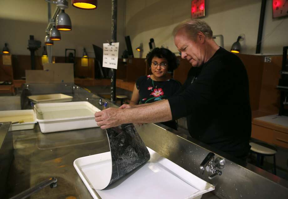 Dave Christensen (right), director of the Harvey Milk Photo Center, works inside the center's large darkroom with staffer Monique Islam in San Francisco, Calif. on Saturday, Aug. 22, 2015. The community photography center, which at one time had Harvey Milk as an active member, is marking its 75th anniversary with a retrospective exhibit by photographer Jeffrey Blankfort. Photo: Paul Chinn, The Chronicle