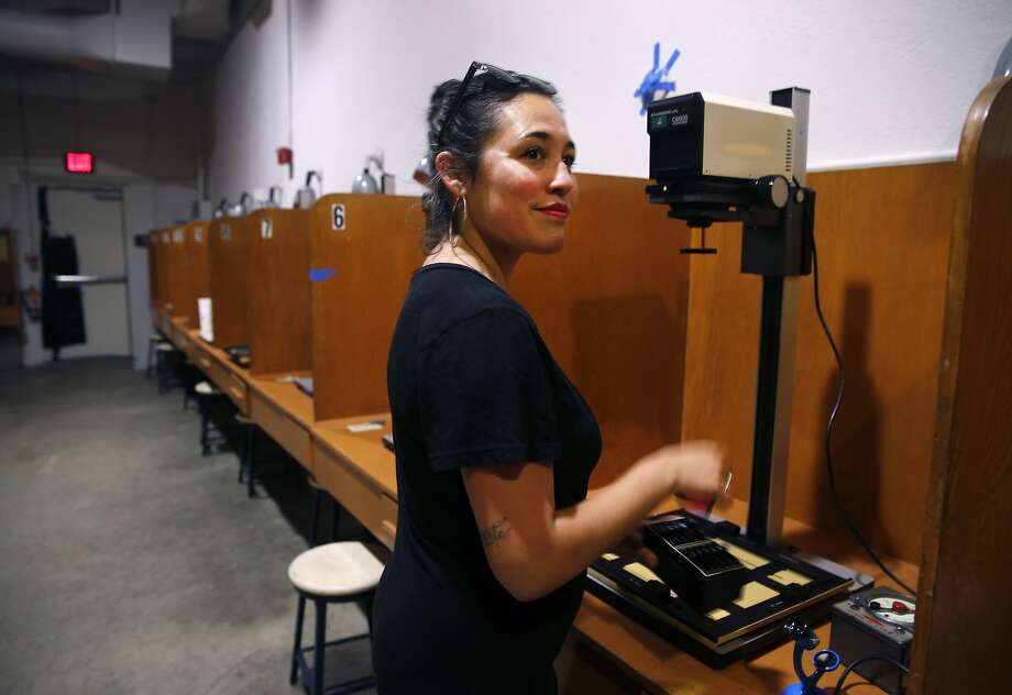 Melissa Gordon prepares to make prints with one of the 40 enlargers in the darkroom. Photo: Paul Chinn, The Chronicle