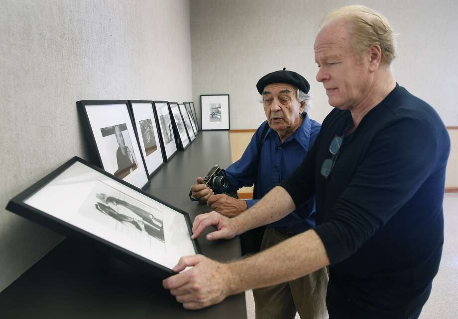 Jeffrey Blankfort (left) reviews his photographs during the installation of an exhibit with Dave Christensen, director of the Harvey Milk Photo Center in San Francisco, Calif. on Saturday, Aug. 22, 2015. The community photography center, which at one time had Harvey Milk as an active member, is marking its 75th anniversary with a retrospective exhibit by Blankfort. Photo: Paul Chinn, The Chronicle