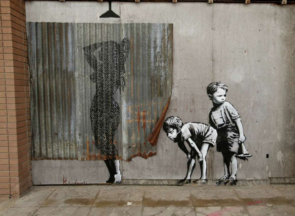 A Banksy piece is displayed at his biggest show to date, entitled 'Dismaland', during a press viewing in Western-super-Mare, Somerset, England, Thursday, Aug. 20, 2015. (Yui Mok/PA Wire via AP) UNITED KINGDOM OUT, NO SALES, NO ARCHIVE