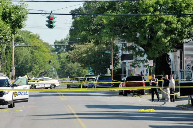 A view looking down 5th Ave., Troy Police work at the scene where two officers were shot Saturday night, on Sunday, Aug. 23, 2015, in Troy, N.Y.    (Paul Buckowski / Times Union)