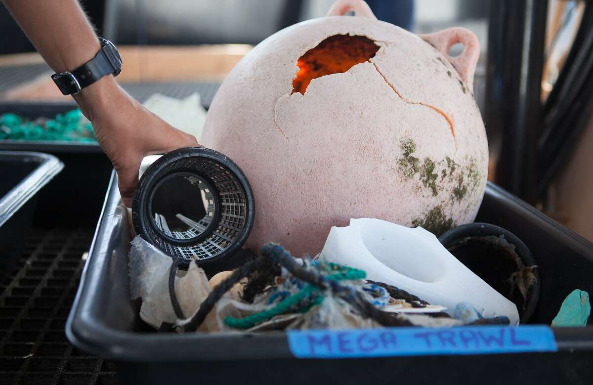 Julia Reisser, lead oceanographer, shows a sample of the garbage collected during the Mega Expedition on Sunday, Aug. 23, 2015 in San Francisco, Calif. The first batch of Mega Expedition vessels arrives in San Francisco after a 30-day voyage mapping the Great Pacific Garbage Patch.