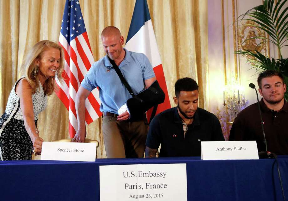 Anthony Sadler, a senior at Sacramento University in California, second right, U.S. National Guardsman from Roseburg, Oregon, Alek Skarlatos, right, U.S. Airman Spencer Stone, second from left, and U.S. Ambassador to France Jane D. Hartley take their seats before a press conference held at the US Ambassador's residence in Paris, France, Sunday, Aug. 23, 2015. Sadler, Skarlatos and Stone helped foil a potentially deadly attack when they subdued a man armed with an assault rifle and other weapons on board a high-speed train bound for Paris two days ago. The man was known to intelligence services in three countries and had ties to radical Islam, authorities said Sunday. (AP Photo/Francois Mori) Photo: Francois Mori, STF / AP