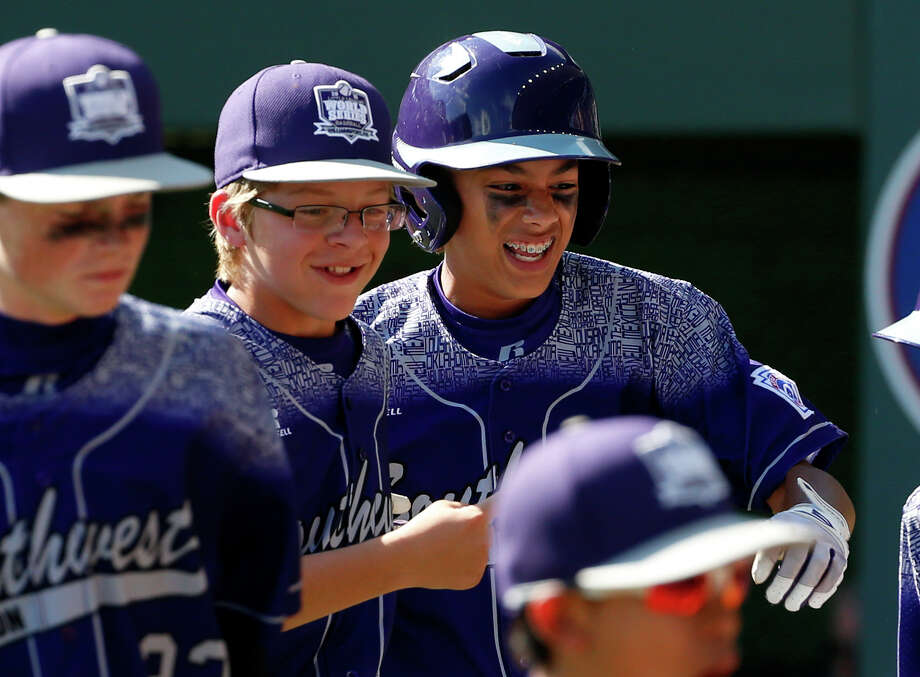 Pearland, Texas' Raffi Gross, right, celebrates with teammates after hitting a two-run home run during the third inning of a baseball game against Bonita, California in United States pool play at the Little League World Series tournament in South Williamsport, Pa., Sunday, Aug. 23, 2015. (AP Photo/Gene J. Puskar) Photo: Gene J. Puskar, Associated Press / AP