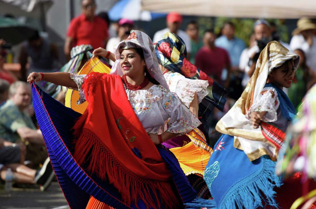 Thalia Merino performs with the dance group Purigcuna at the Summer Fiesta Festival at the DOMUS Foundation in Stamford, Conn. Sunday, Aug. 23, 2015. The festival featured many international music artists and dance acts, as well as games and activities for kids. The evening culminated with performance of the Native Instrument Academy Summer Camp Grand Community Choir.