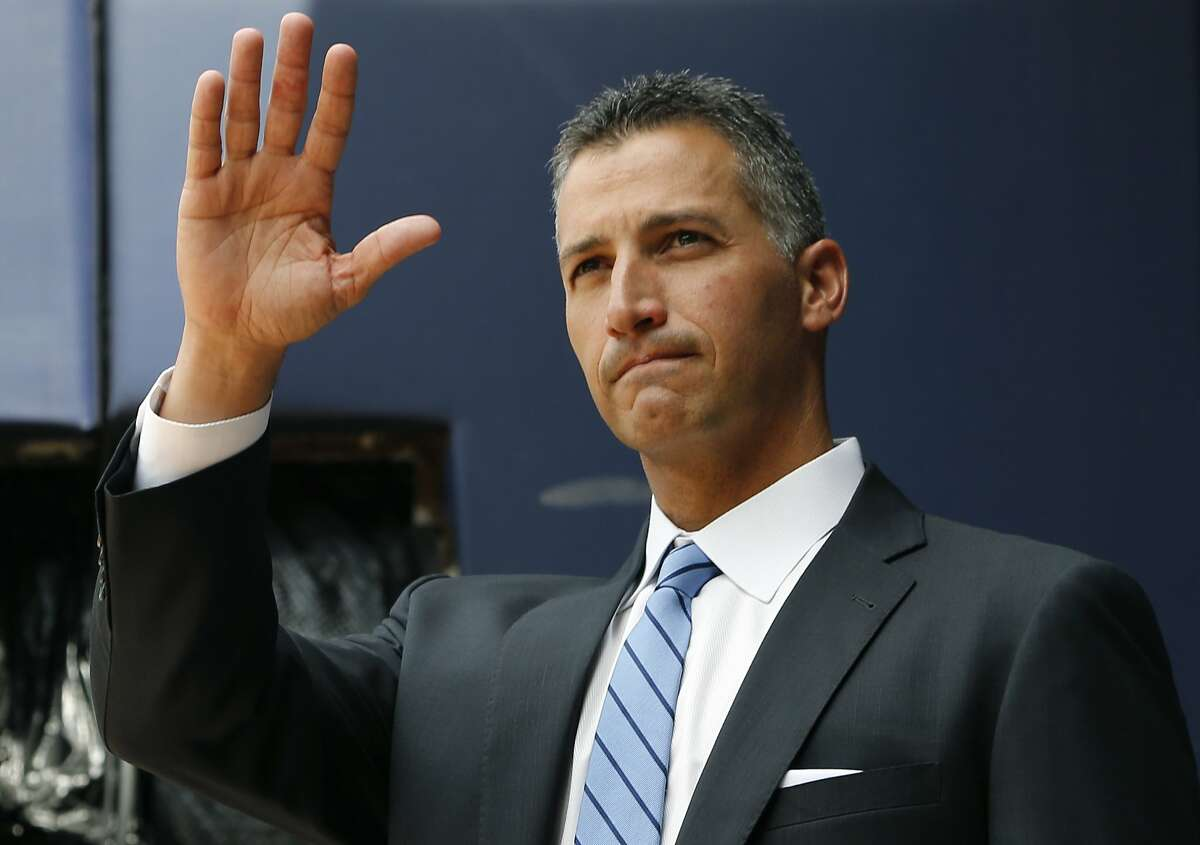 Retired New York Yankees pitcher Andy Pettitte waves to fans as he is introduced from the bullpen during a pregame ceremony retiring his number before a baseball game in New York, Sunday, Aug. 23, 2015. The Yankees retired Pettitte's No. 46 Sunday. (AP Photo/Kathy Willens)