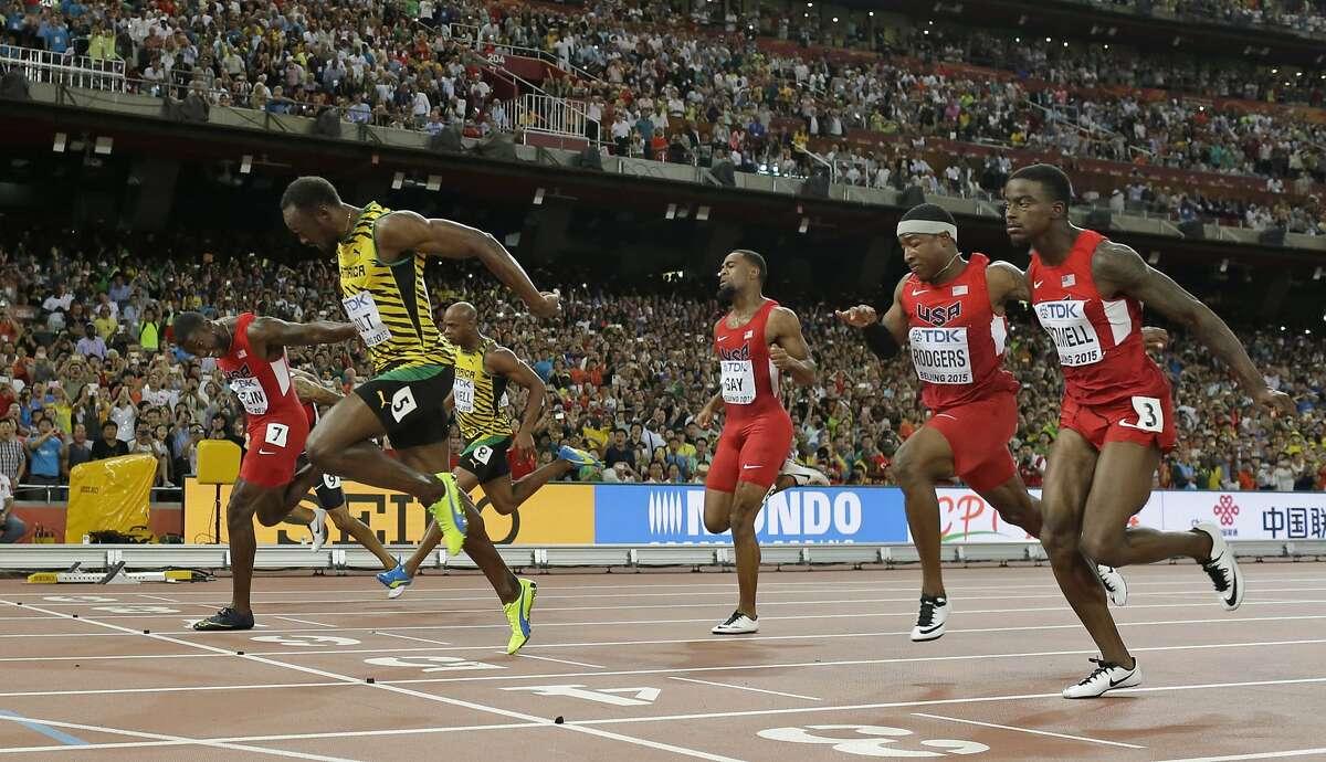 Bolt runs down Gatlin in 100 finals at world championships