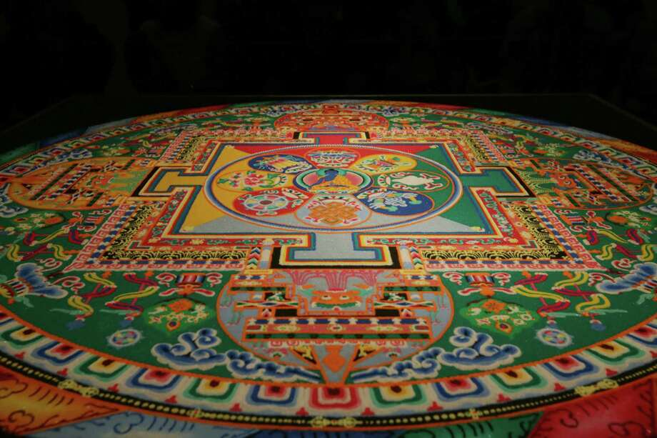 A finished mandala sand painting at the Asia Society Texas Center, completed by monks from the Drepung Loseling Monastery in India, waits for the sweeping ceremony Sunday, Aug. 23, 2015, in Houston. The ceremonial creation and destruction of the mandala symbolizes the impermanence of the world, and it serves as a blessing for it. Photo: Jon Shapley, Houston Chronicle / © 2015 Houston Chronicle