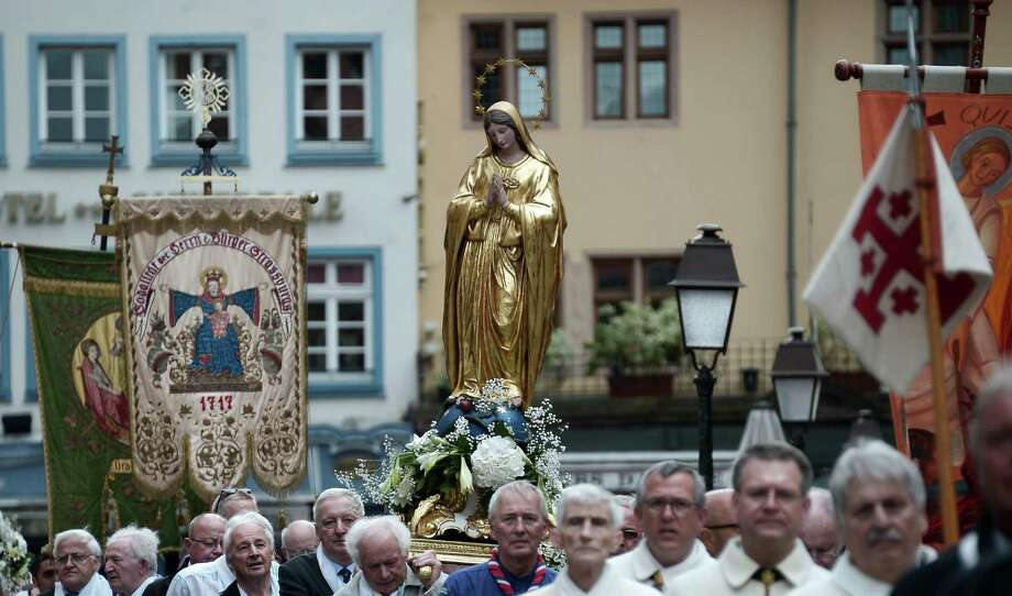 Faithfuls carry the statue of the Virgin Mary as they take part in a religious procession on the Feast of the Assumption in the streets of Strasbourg, eastern France on August 15, 2015 . Photo: FREDERICK FLORIN /AFP / Getty Images / AFP