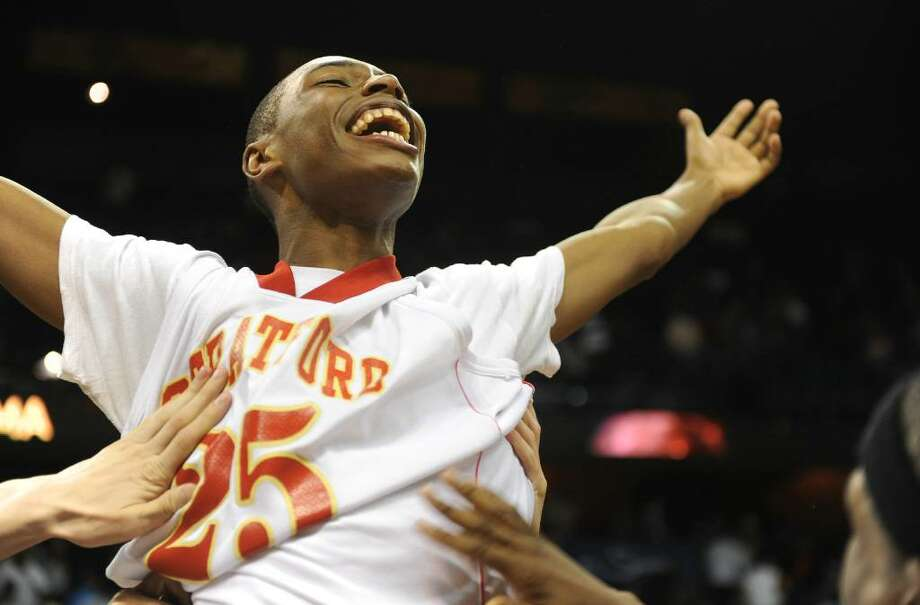 Stratford's #25 Bernard Brantley waves his arms in the air as he is held up by his teammates after they beat New London, during Class L state championship action at Mohegan Sun Arena in Uncasville, Conn. on Saturday Mar. 20, 2010. Stratford edged out New London 51-47. Photo: Christian Abraham / Connecticut Post