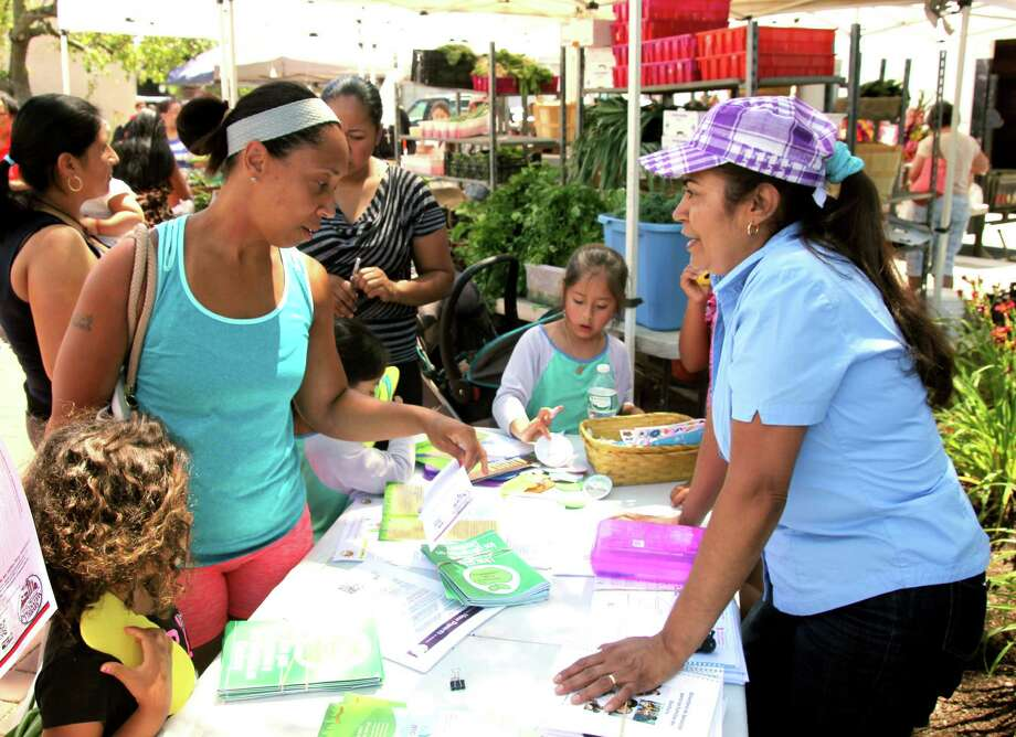 Miguelina Matista, right, benefited from early childhood programs for her daughter, Nicaury, and son, Noel, seven years ago. Now she is volunteering to let other Danbury parents know about free programs offered through social services agencies. Photo: Jodie Mozdzer Gil / Contributed Photo