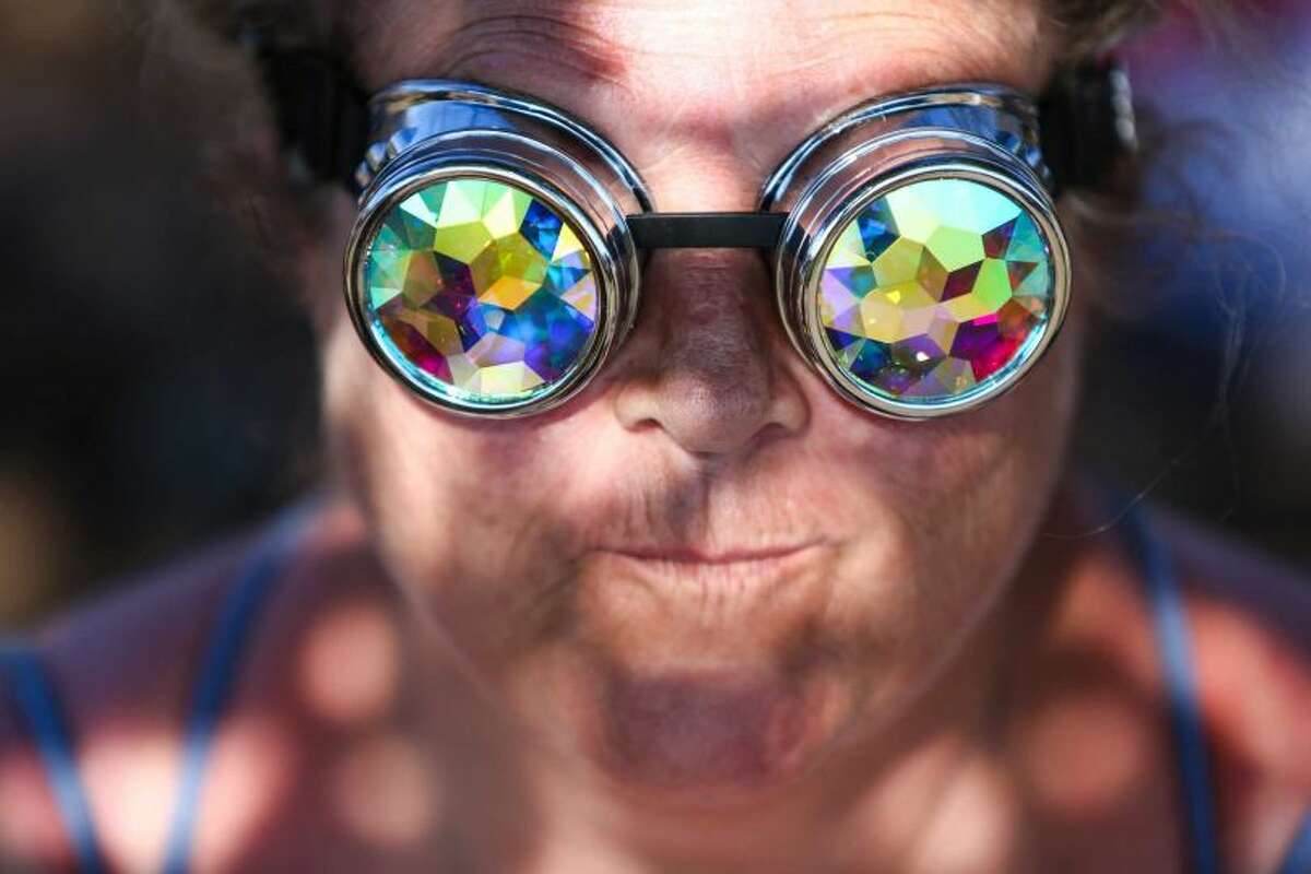 A participant wears goggles during Hempfest, the annual cannabis freedom festival at Myrtle Edwards Park on the Seattle waterfront. The three day festival is an annual Seattle tradition that started in 1991. Photographed on Sunday, August 16, 2015.