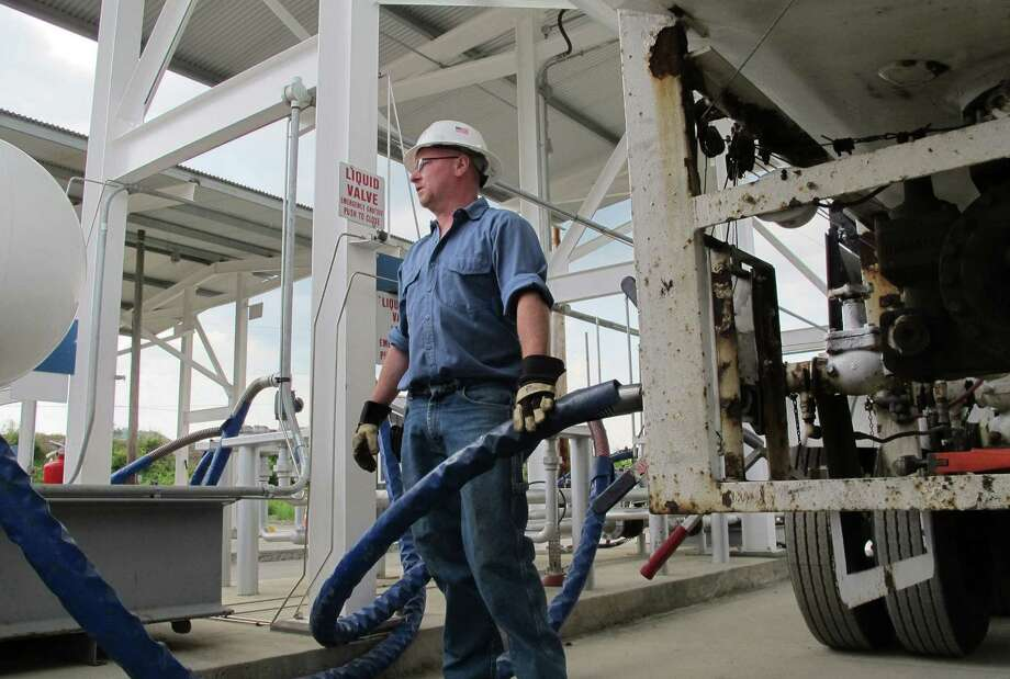 Larry Rice unloads propane from a tanker truck for storage at a facility in Bath, N.Y. Propane is a byproduct of the booming oil and gas industry. Photo: Tribune News Service File Photo / MCT