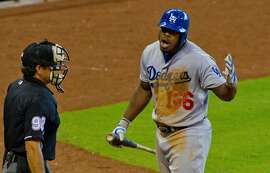 Los Angeles Dodgers' Yasiel Puig argues after being ejected by home plate umpire James Hoye during the ninth inning of a baseball game Sunday, Aug. 23, 2015, in Houston.  (AP Photo/Richard Carson)