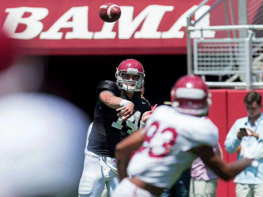 Alabama quarterback Jake Coker (14) works through drills during NCAA college football practice, Saturday, Aug. 22, 2015, at Bryant-Denny Stadium in Tuscaloosa, Ala. (Vasha Hunt/AL.com via AP) MAGS OUT; MANDATORY CREDIT, TV OUT Photo: Vasha Hunt, MBI / Associated Press / AL.com