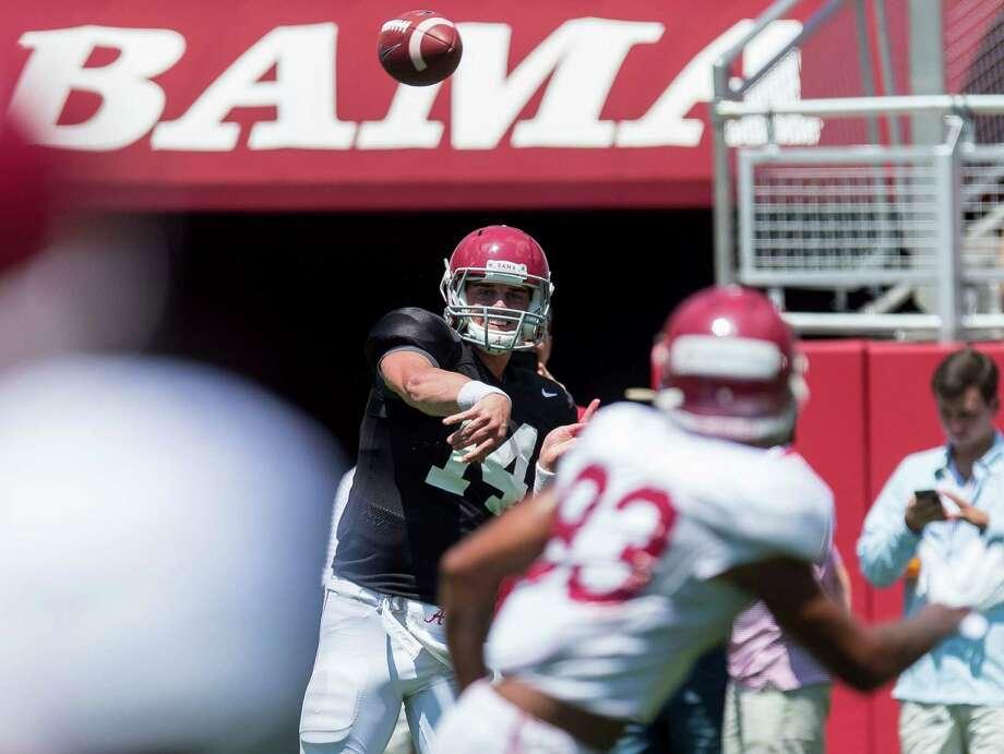 Alabama quarterback Jake Coker (14) works through drills during NCAA college football practice, Saturday, Aug. 22, 2015, at Bryant-Denny Stadium in Tuscaloosa, Ala. (Vasha Hunt/AL.com via AP) MAGS OUT; MANDATORY CREDIT, TV OUT Photo: Vasha Hunt, MBI / Associated Press / AL.com