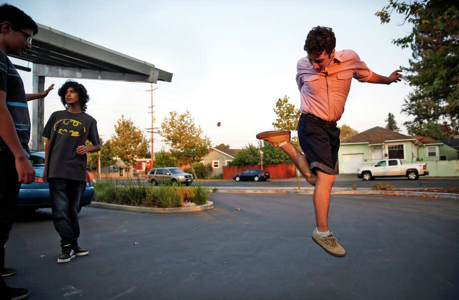 Nicholas Dillon, whose pelvis was broken when a chimney fell on him during the 2014 quake, kicks up a rock while taking a break from a dance rehearsal for a Quinceañera at New Technology High School in Napa. Photo: Scott Strazzante / Photos By Scott Strazzante / The Chronicle / ONLINE_YES