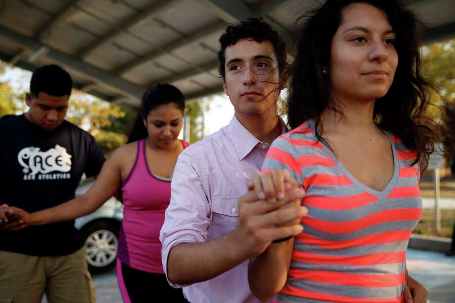 Nicholas Dillon, who broke his pelvis when a chimney fell on him during the 2014 earthquake, dances with Jacqueline Salgado as he takes part in a dance rehearsal for Gabriella and Juliana Silva's quinceanera in the parking lot of New Technology High School in Napa, Calif., on Thursday, Aug. 20, 2015. Photo: Scott Strazzante / The Chronicle / ONLINE_YES