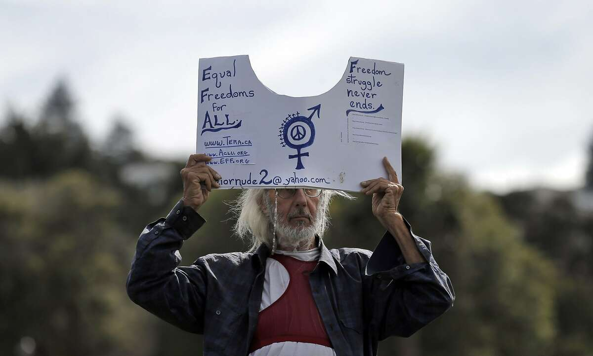 Tortuga Liberty holds a sign in support of Go Topless Day at Dolores Park in San Francisco, Calif., on Sunday, August 23, 2015. The group GoTopless.org is organized Go Topless Day on the Sunday closest to Women's Equality Day, Aug 26. It is indeed on Aug 26, 1920 that women earned their right to vote on the basis of Gender Equality. In 1971, the US Congress has made Aug 26 into a nationally recognized date and named it