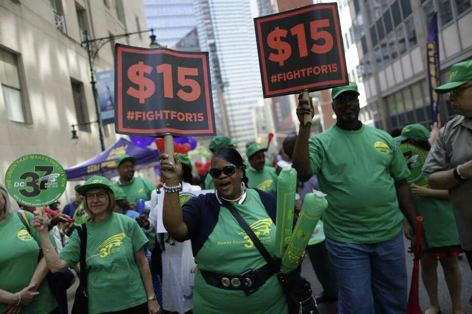 Activists cheer during a rally after the New York Wage Board endorsed a proposal to set a $15 minimum wage for workers at fast-food restaurants with 30 or more locations, Wednesday, July 22, 2015 in New York. The increase would be phased in over three years in New York City and over six years elsewhere. (AP Photo/Mary Altaffer) ORG XMIT: NYMA112 ORG XMIT: MER2015072510122177 Photo: Mary Altaffer / AP