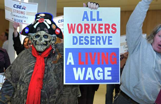 Fast food workers and others gather to march across the concourse in support of a $15 per hour minimum wage at the Empire State Plaza on Wednesday, April 15, 2015 in Albany, N.Y. (Lori Van Buren / Times Union) ORG XMIT: MER2015041516313623 Photo: Lori Van Buren / 00031444A
