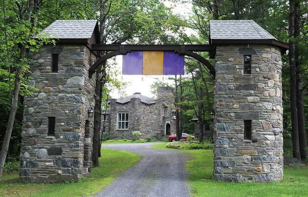 Entryway to Thom Breitenbach's castle he's made out of local stone which is also a wedding venue on Monday, Aug. 17, 2015 in Altamont, N.Y. He is also an artist and plans to leave the castle and his paintings as a museum when he dies. (Lori Van Buren / Times Union) Photo: Lori Van Buren / 00032981A