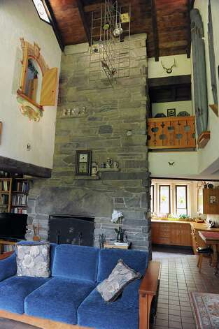 Interior of Thom Breitenbach's castle he's made out of local stone which is also a wedding venue on Monday, Aug. 17, 2015 in Altamont, N.Y. He is also an artist and plans to leave the castle and his paintings as a museum when he dies. (Lori Van Buren / Times Union) Photo: Lori Van Buren / 00032981A