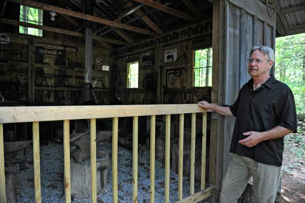 Thom Breitenbach stands next to his blacksmith building next to his castle he's made out of local stone which is also a wedding venue on Monday, Aug. 17, 2015 in Altamont, N.Y. He is also an artist and plans to leave the castle and his paintings as a museum when he dies. (Lori Van Buren / Times Union) Photo: Lori Van Buren / 00032981A