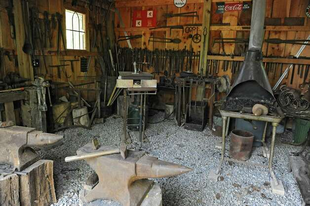 Interior of Thom Breitenbach's blacksmith building next to his castle he's made out of local stone which is also a wedding venue on Monday, Aug. 17, 2015 in Altamont, N.Y. He is also an artist and plans to leave the castle and his paintings as a museum when he dies. (Lori Van Buren / Times Union) Photo: Lori Van Buren / 00032981A