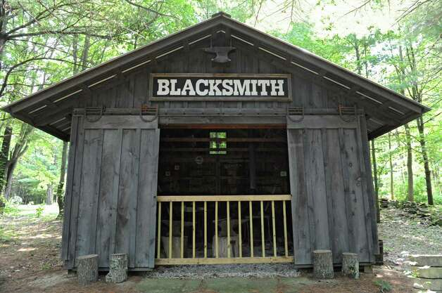 Exterior of Thom Breitenbach's blacksmith building next to his castle he's made out of local stone which is also a wedding venue on Monday, Aug. 17, 2015 in Altamont, N.Y. He is also an artist and plans to leave the castle and his paintings as a museum when he dies. (Lori Van Buren / Times Union) Photo: Lori Van Buren / 00032981A