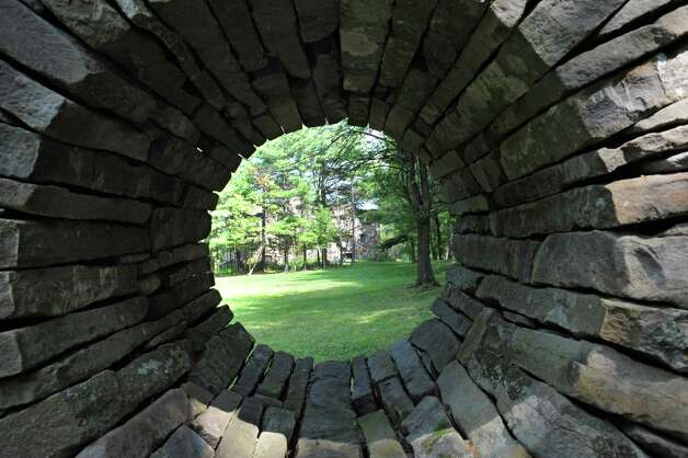 Part of stone wall with archway on Thom Breitenbach's property where he owns a castle he's made out of local stone which is also a wedding venue on Monday, Aug. 17, 2015 in Altamont, N.Y. He is also an artist and plans to leave the castle and his paintings as a museum when he dies. (Lori Van Buren / Times Union) Photo: Lori Van Buren / 00032981A